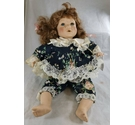Doll with brown hair, blue eyes and floral dress