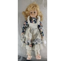 Doll with blonde hair, blue eyes and floral dress
