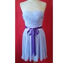 Short Lilac Bridesmaids Dress With a Purple Ribbon Wrapped around the Waist