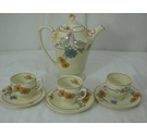 Woods Ivory Ware Coffee Pot and Three Cups and Saucers