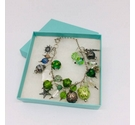Button, bead and charm bracelet in shades of green and silver - Upcycled