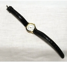 Unbranded ladies gold-tone wristwatch with brown strap.