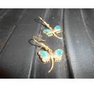 Pair of yellow toned earrings with blue enamel on wings