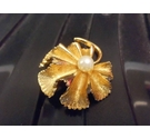 Gold toned flower brooch with large pearl in centre