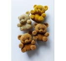Four teeny tiny flocked bears