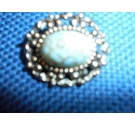 Pewter toned oval vintage brooch centre stone blue with brown scrolls on the blue