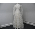 Amazing handmade vintage lace wedding dress with beautiful V neck and floor length wide bottom