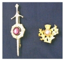 Vintage Claymore Scottish brooch and a thistle brooch