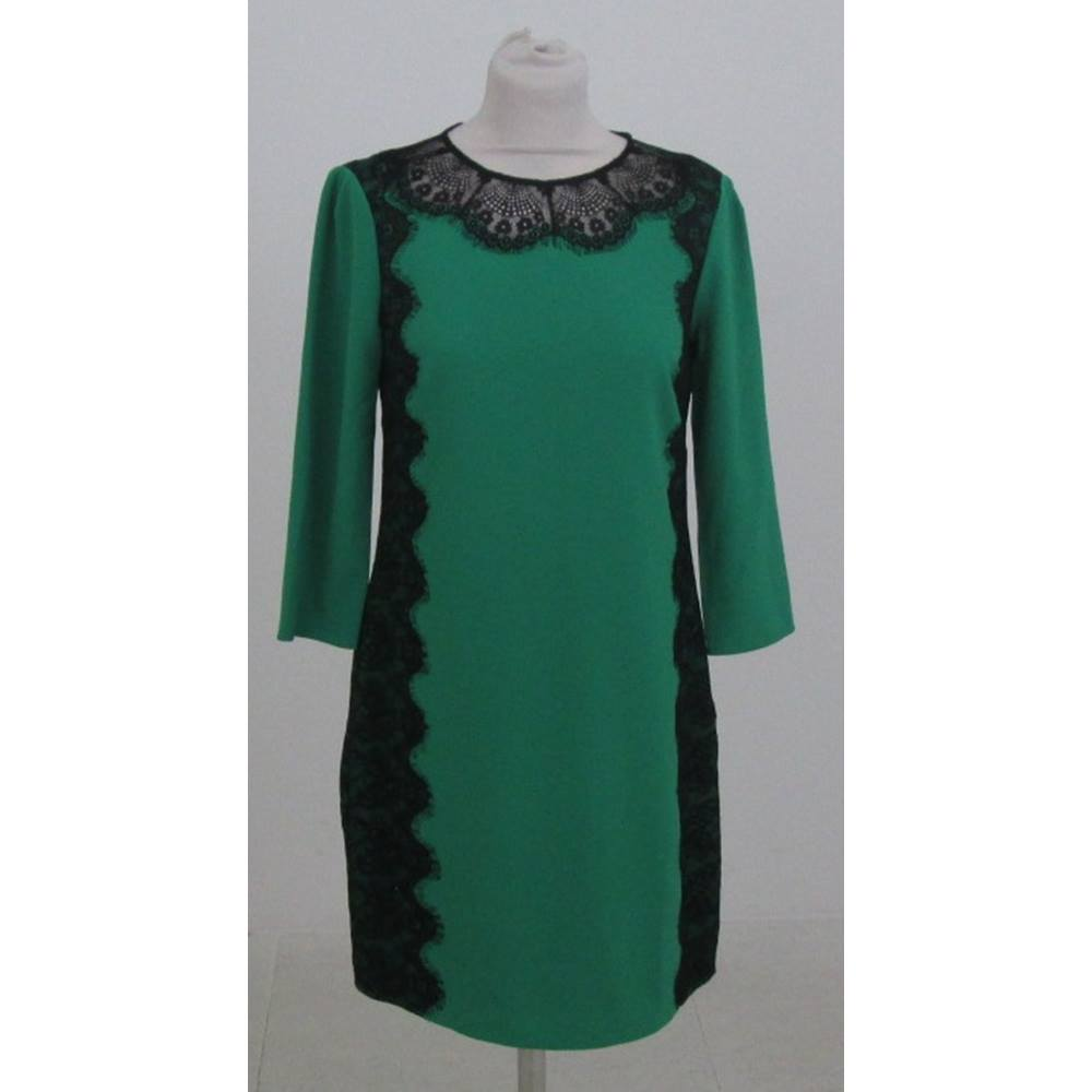 d1575c9605d9 ... cocktail dress by Ted Baker has a round neck