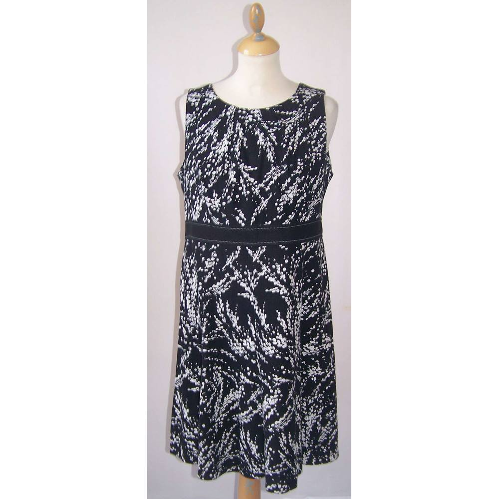 90284bec183f Oxfam Shop Ulverston Very stylish black and white print dress. Gathered at  the round neckline. Nice black feature around the waist. Petite size. 36