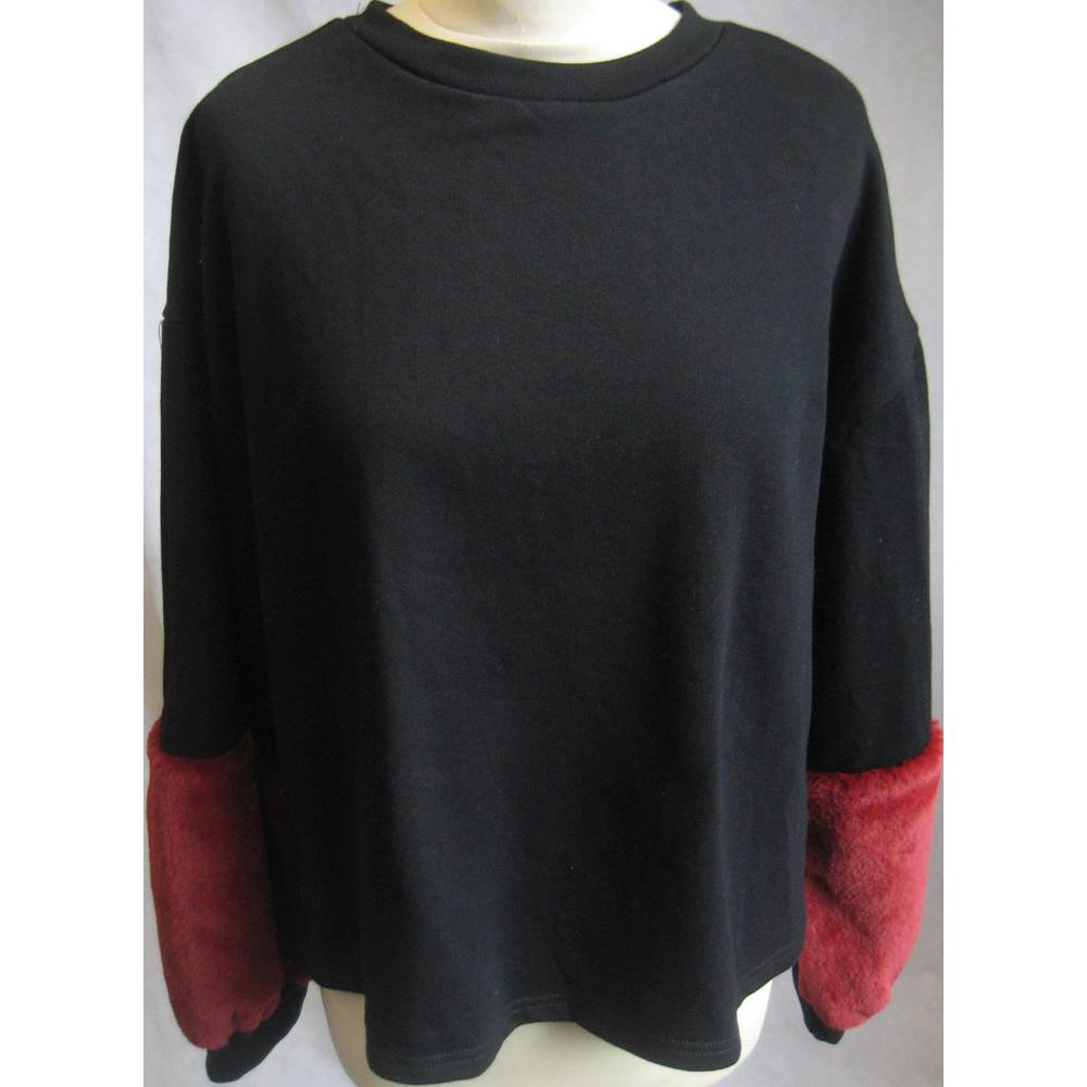 0152e4f7 Hers & Mine black sweatshirt red fur sleeves L BNWT Hers & Mine - Size:  Loading zoom. Rollover to zoom