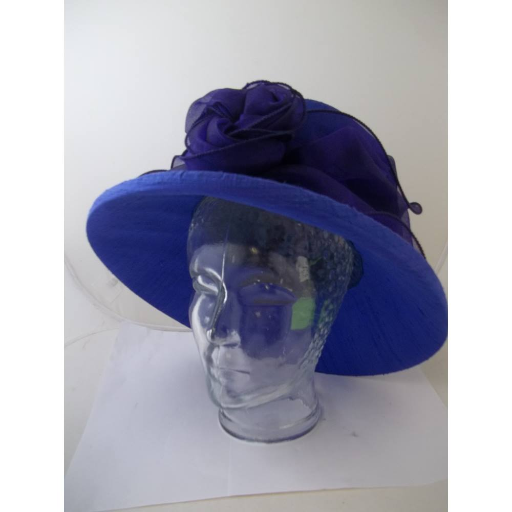 Oxfam Shop Truro This gorgeous royal blue hat is by brand name d2e5b3fd2b4