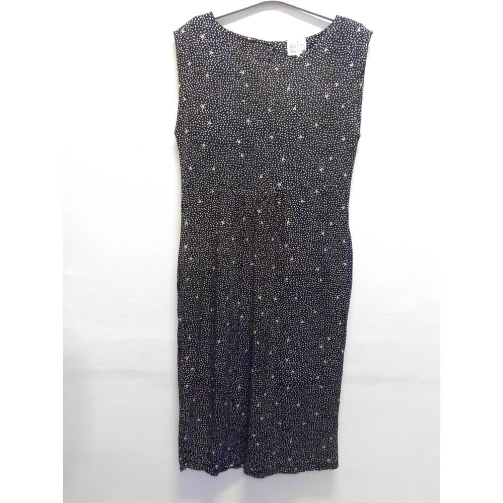 9f501de0689 Oxfam Shop Clitheroe Dress in in smooth and elegant viscose decorated with  lovely small dots and butterflies. Otherwise the dress is completely  simple, ...
