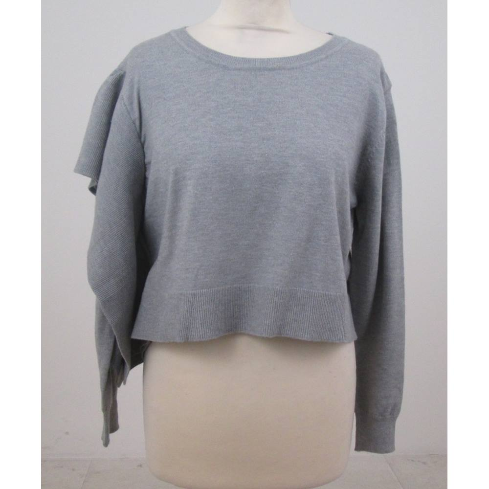 a149ad867fe4 ... chic to your casual collection with this cute cropped knit jumper. It  has a ribbed matching-fabric layer on one side over the arm