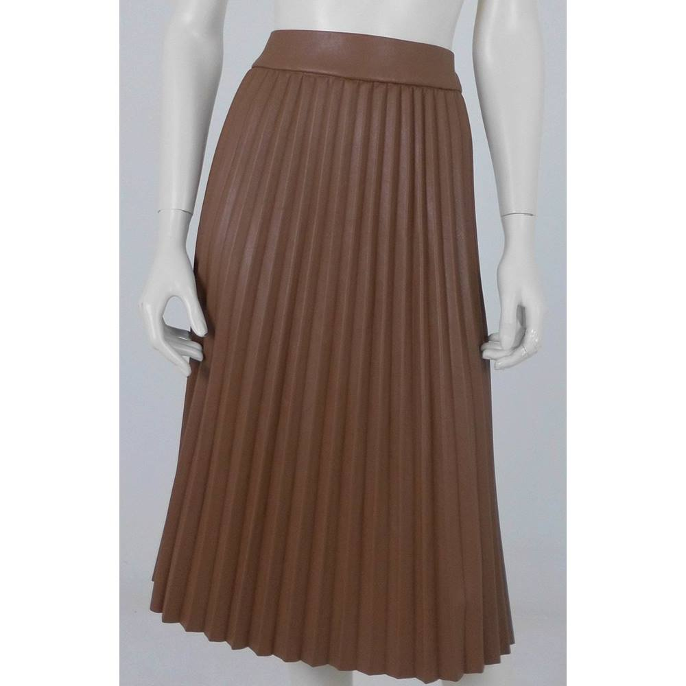 1119fab4da ... Marks & Spencer Tan Faux Leather Pleated Skirt Size 18 Try pairing with  a simple white T and battered leather jacket for a fun, rock chic look.