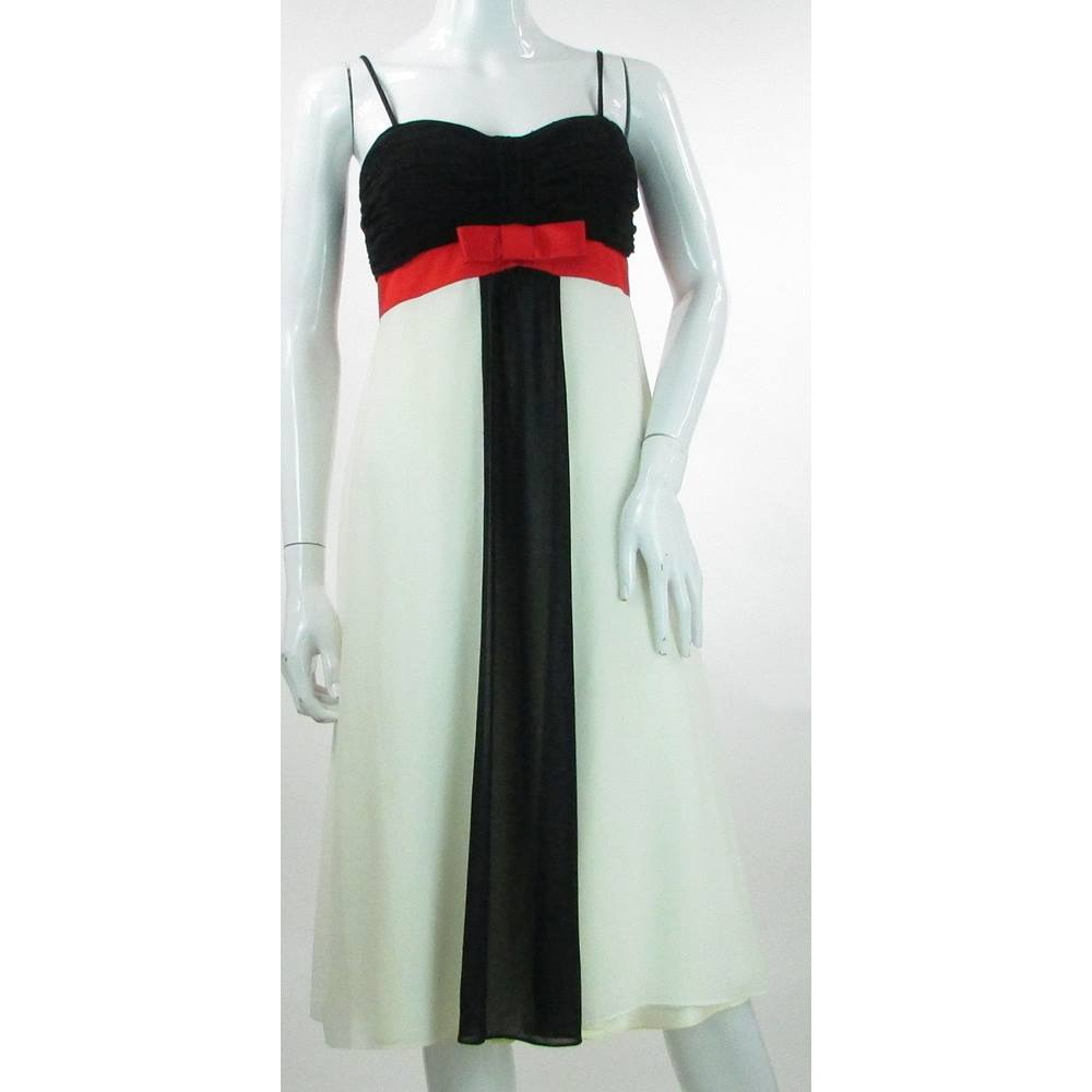 39d422cd407c ... Size 10 Black, White & Red Knee Length Dress This formal dress from  Debut by Debenhams dress features a bold blocking of white and black with a  stripe.