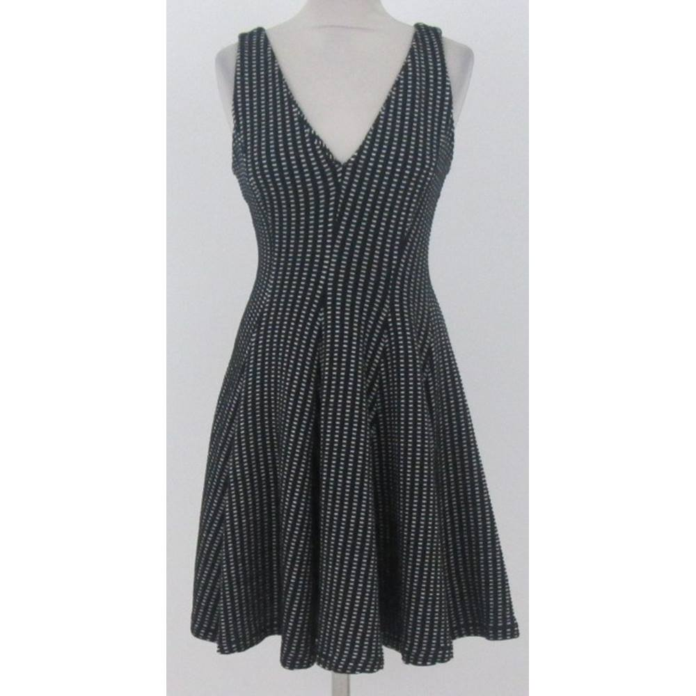 39de73b4 Oxfam Online Hub Milton Keynes Add a bit of bold contrast to your going-out  look with this charming black and white skater dress from Zara Woman.