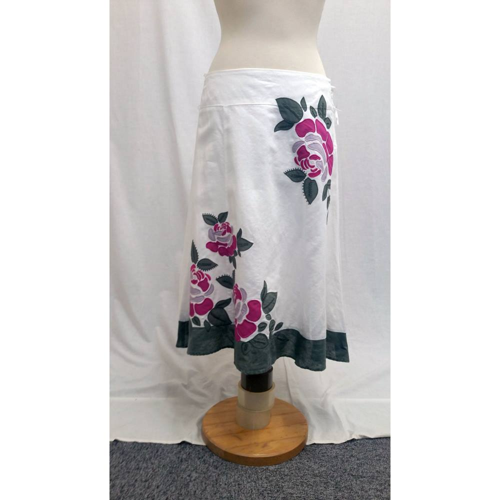 f634cfacdf Oxfam Shop Malvern Size 12 Linen skirt by Monsoon Main colour is linen white  Has embroidered green hem and green/purple floral motif Hanging loops  Fastens ...