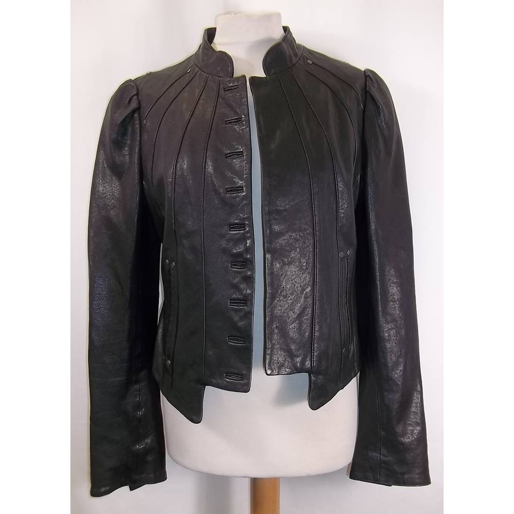 8bb3b70d Oxfam Shop London Attractive black leather jacket, full sleeve and ready to  rock. Minor sains in the interior. Small cut on the back.