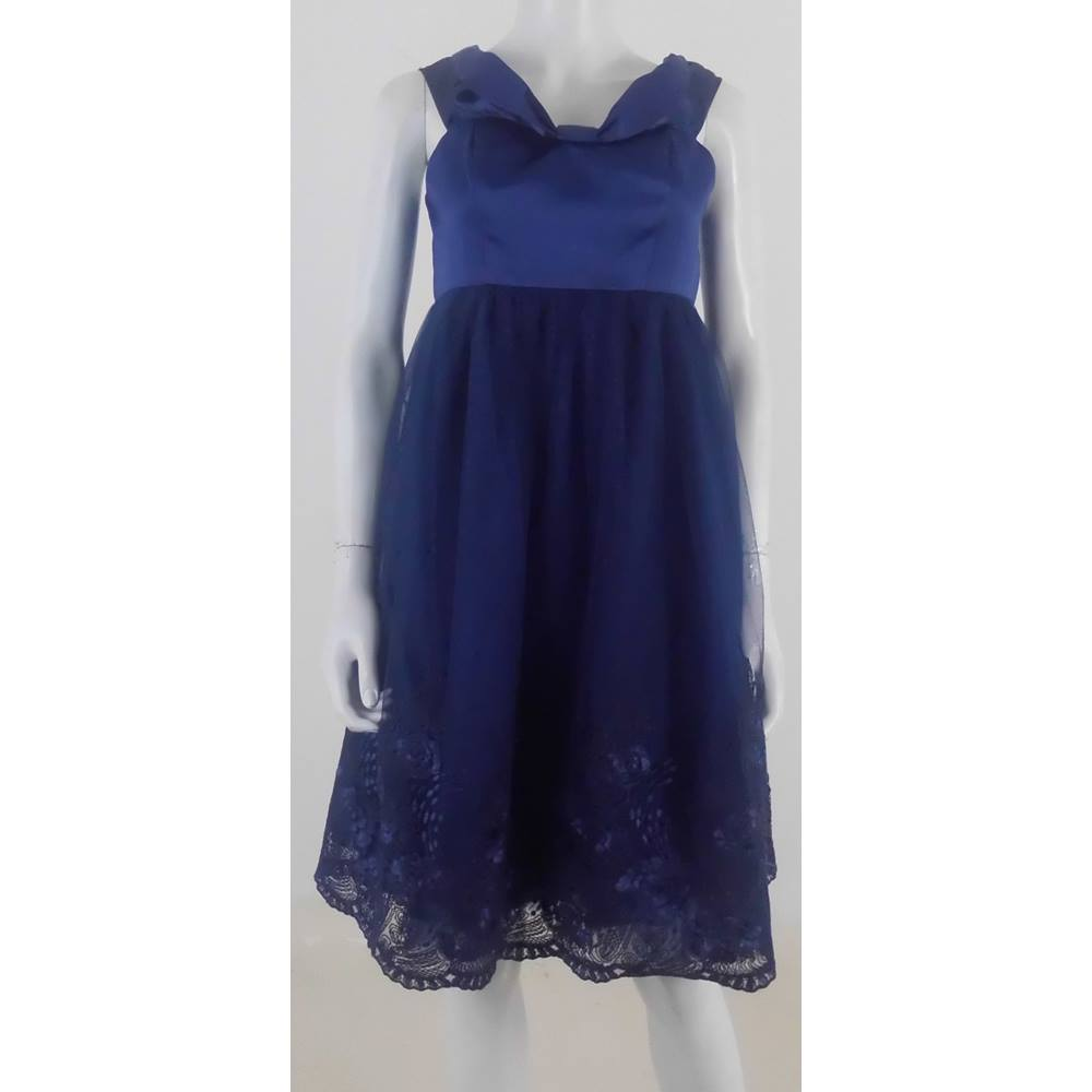 Preview of the first image of Chi Chi London Poofy Prom dress Navy Blue Size: 8.