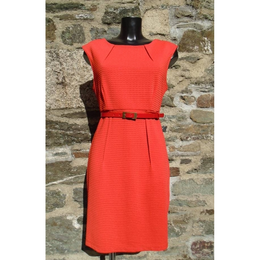 Preview of the first image of Darling knee length fitted dress Orange Size: L.