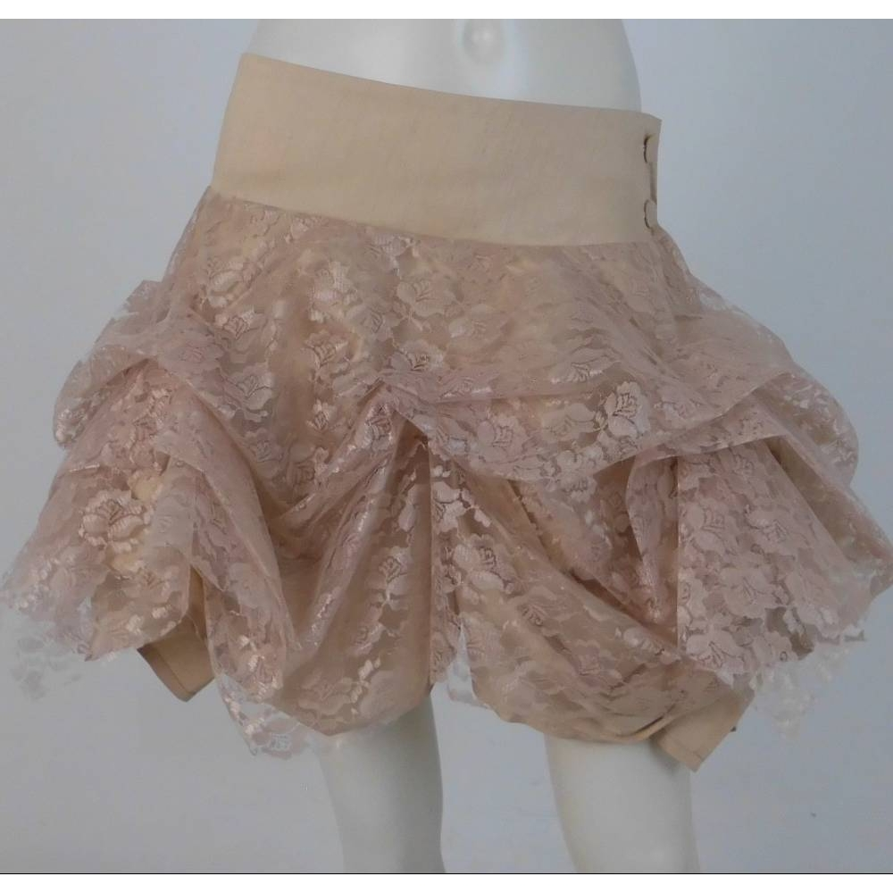 Preview of the first image of BNWT Kelly Ewing Lace Hem Detail Mini Skirt Beige Size: 12.