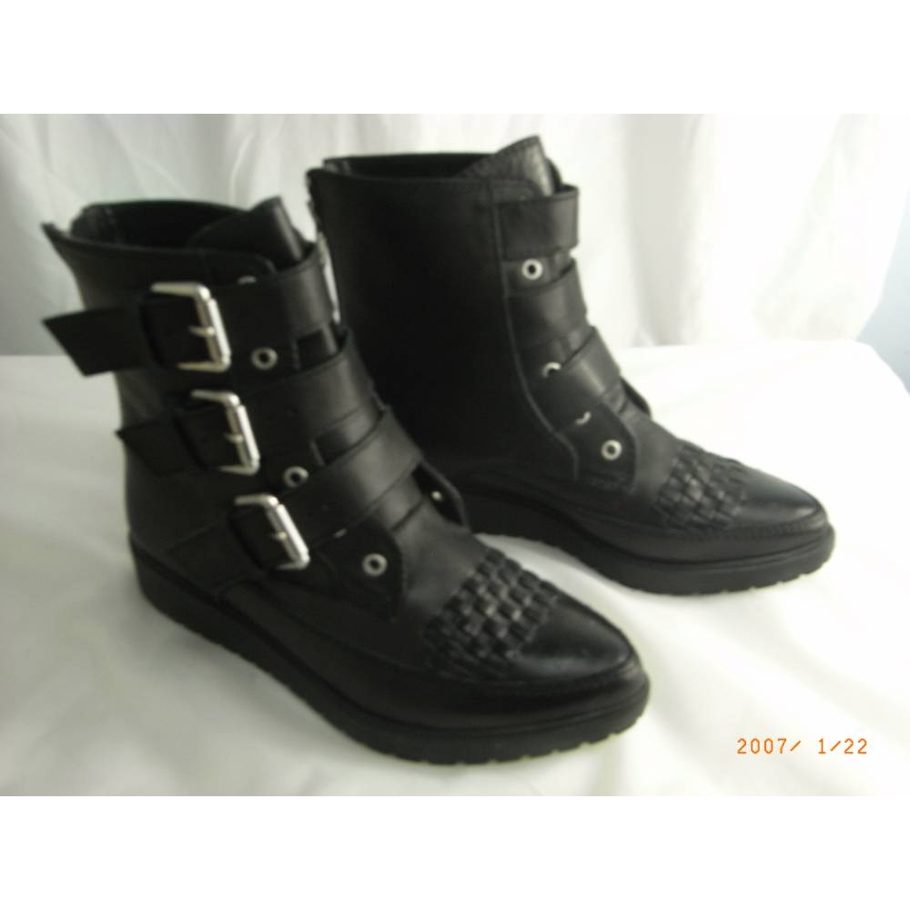 Preview of the first image of Shellys London Flat Buckle Strap Ankle Boots Black Leather Size: 5.5.