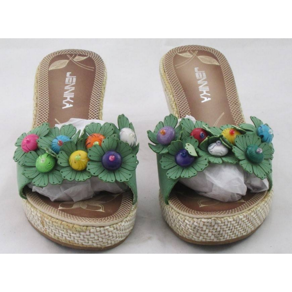 Preview of the first image of Jennika Wedge Heeled Flower Mules Green Size: 4.