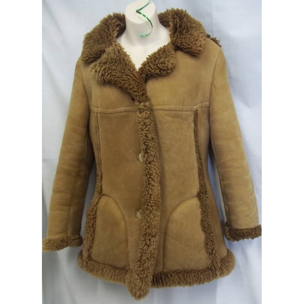 Preview of the first image of Bailys of Glastonbury Sheepskin Coat Tan Size: 14.